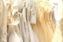 Bunch of wedding dresses stock photography