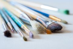 A bunch of well used paintbrushes Stock Photos