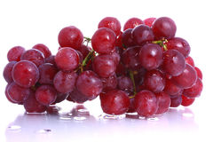 Bunch of wet red grapes. On a white background royalty free stock images