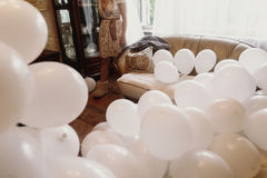 Bunch of white air balloons in luxury hotel room, morning before Royalty Free Stock Photos