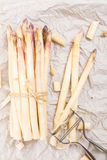 Bunch of white asparagus with peelings Stock Image