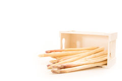 Bunch of white asparagus spears in a box, on white background Royalty Free Stock Photo