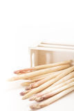 Bunch of white asparagus spears in a box, on white Royalty Free Stock Photos