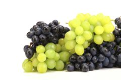 Bunch of white and black grapes. Stock Image