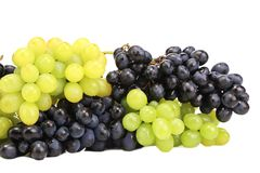 Bunch of white and black grapes. Stock Images