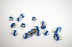 A bunch of white blue potentiometer. On a white background royalty free stock photo