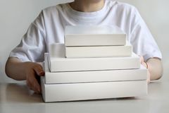 A bunch of white boxes in their hands royalty free stock photo