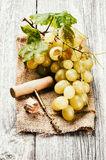 Bunch of white grape in rustic setting Stock Image