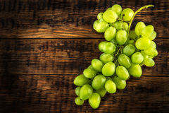 Bunch of white grape on wooden table Royalty Free Stock Photo