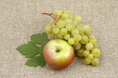 Bunch of white grapes and apples Stock Photos