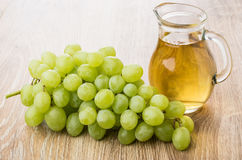 Bunch of white grapes and jug of grape juice Royalty Free Stock Image