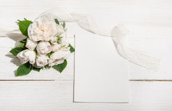 Bunch of white roses on white table Royalty Free Stock Photo