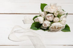 Bunch of white roses on white table Royalty Free Stock Photography