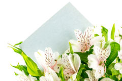 Bunch of white tiger lilies with a blank card Royalty Free Stock Images