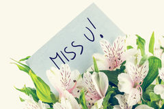Bunch of white tiger lillies with a Miss u card Royalty Free Stock Images