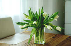 Bunch of white tulips in a glass vase Stock Photography