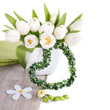 Bunch of white tulips and matching spring decorations on wood is. Olated on white. Can be used as corner decoration for Easter, March 8 or Mother's day designs Stock Images