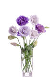 Bunch of white and violet eustoma flowers in glass vase Royalty Free Stock Photography