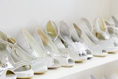 Bunch of white wedding shoes from the left side Royalty Free Stock Images