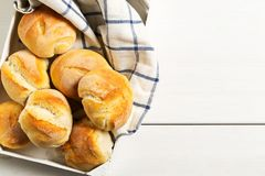 Bunch of whole, fresh baked wheat buns with wheat ears on white Royalty Free Stock Photography