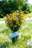 Bunch of wild meadow flowers as a part of natural wedding ceremony decoration. royalty free stock photo