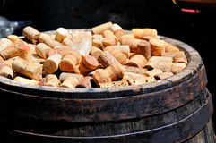 Bunch of wine corks. Corks from wine bottles on wooden old barrel royalty free stock photo