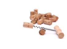 Bunch of wine corks and corkscrew. Isolated on white Stock Photography