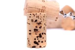 Bunch of wine corks and corkscrew. Isolated on white Royalty Free Stock Image