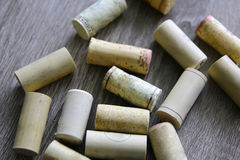 Bunch of wine corks on wooden table. Stock Photo