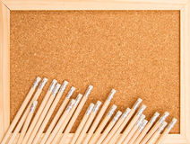 Bunch of wooden pencils. Over a cork board Stock Photography