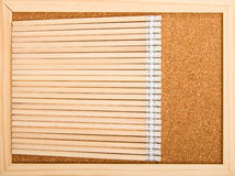 Bunch of wooden pencils. Over a cork board Stock Image