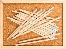 Bunch of wooden pencils. Over a cork board Royalty Free Stock Photography