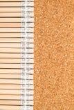 Bunch of wooden pencils. Over a cork board Stock Photos