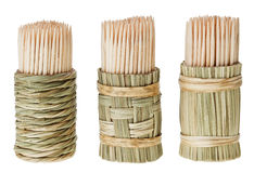 Bunch of wooden toothpick in round straw holder Stock Image