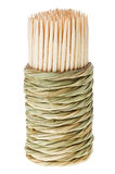 Bunch of wooden toothpick in round straw holder Royalty Free Stock Photos