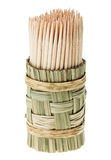 Bunch of wooden toothpick in round wattled holder Royalty Free Stock Photos
