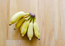 Bunch of yellow banana. Bunch of yellow banana with natural light on wooden floor Royalty Free Stock Image