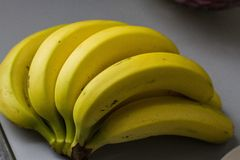 Bunch of yellow bananas ripe and ready royalty free stock photos