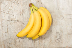 Bunch of Yellow Bananas on a Wooden Background Royalty Free Stock Photography