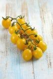 Bunch of yellow cherry tomatoes Stock Photos
