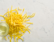 A bunch of yellow Lasha on a white stone background. Royalty Free Stock Photos