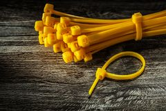 Bunch of yellow plastic cables on vintage wooden board stock photos