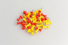 Bunch of yellow and red office buttons on gray Stock Photo