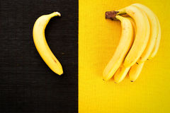 Bunch of yellow ripe bananas from the tropics with a black bambo Royalty Free Stock Image