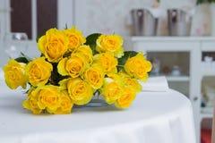 Bunch of yellow roses. A bunch of yellow rosess on a restaurant table Royalty Free Stock Photos