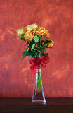 Bunch of yellow roses. On red stucture background Stock Photos