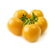 Bunch of yellow tomato over white background. Bunch of five yellow tomato isolated over white background Stock Photography