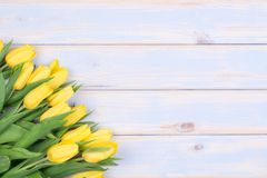 Yellow tulips on wooden background with copy space Royalty Free Stock Image