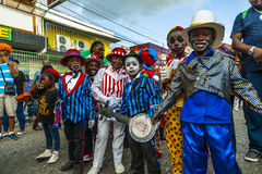 A bunch of young boys dressed as minstrels at Carnival time. A bunch of young boys dressed as minstrels with banjo in hand and red and white and black and blue Stock Photos