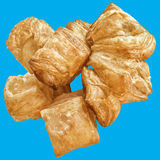 Bunch of Zu-Zu Square Sesame Croissant Puff Pastry Isolated on Blue Background Stock Photo